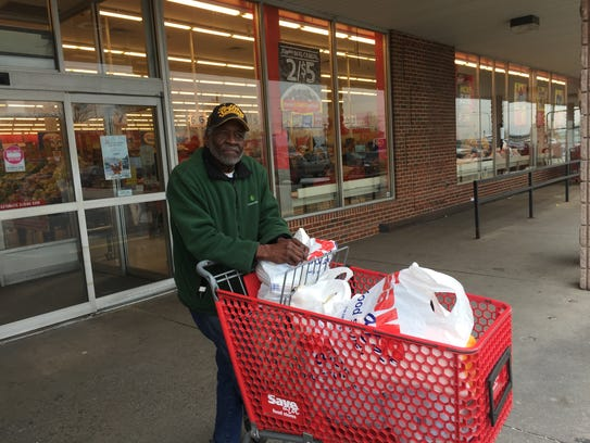 Willis Phelps buys fruit, canned goods, and cooking