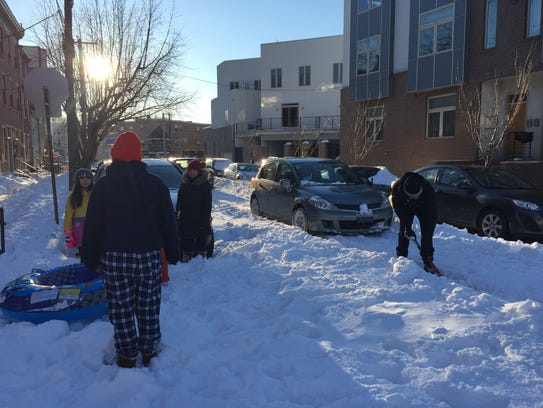 Residents in Philadelphia dig out a side street Sunday