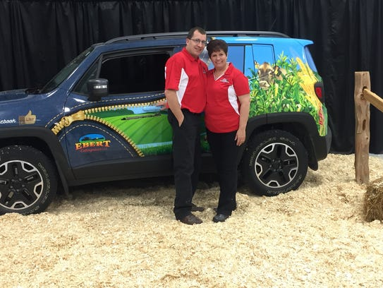 """Randy and Renee Ebert with their car, """"Ag ProMotor,"""
