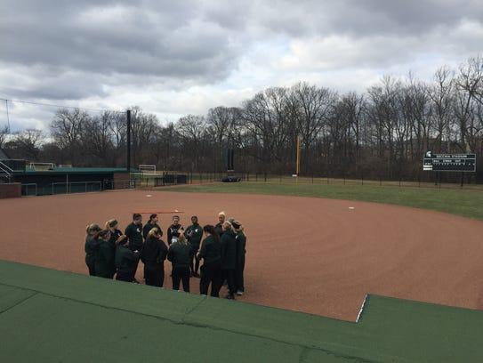 MSU's softball team prepares to practice Monday on