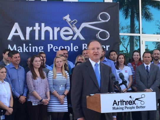 Arthrex founder and CEO Reinhold Schmieding addresses a crowd for an announcement with the governor on jobs creation.