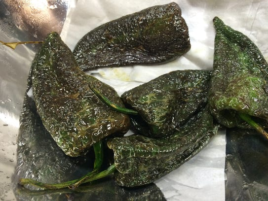 Roasted poblano peppers in the kitchen at Casa Del