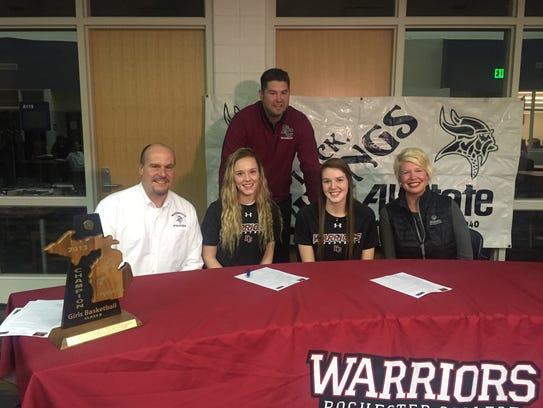 Marysville Athletic Director Tom Valko alongside daughters