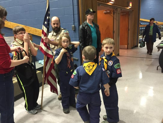 Essex cub scouts carried the flag into the town meeting