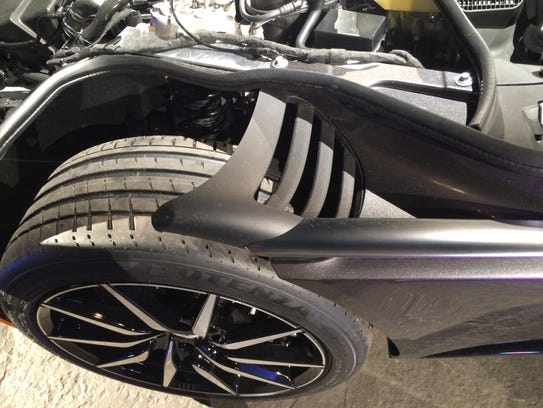 Cutouts behind the front wheel help with aerodynamics.