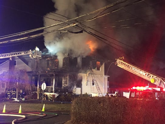Firefighters battling a a house blaze in Mamaroneck
