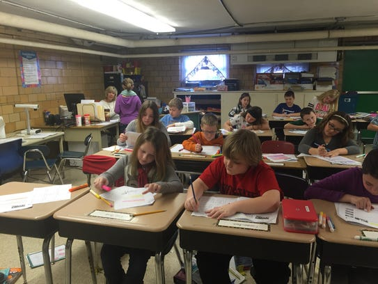 Fourth-graders work on English language arts in a lower-level
