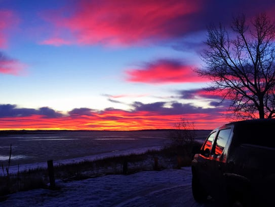 Sunrise turns vibrant at Fort Peck Dam.