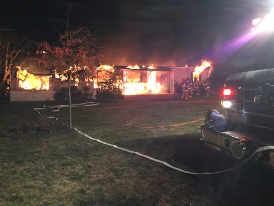 A fire destroyed a mobile home and resulted in a man's