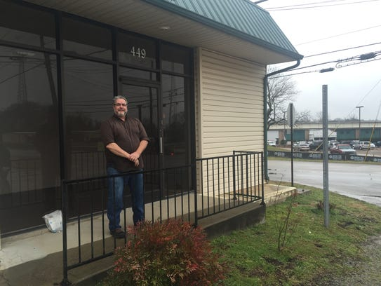 Brad Blomgren stands in front of the new location for
