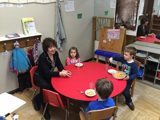 Shirley McNulty visits with school-age kids at Park
