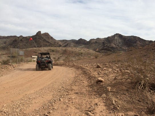 An ultra-terrain vehicle embarks on the rough five-mile