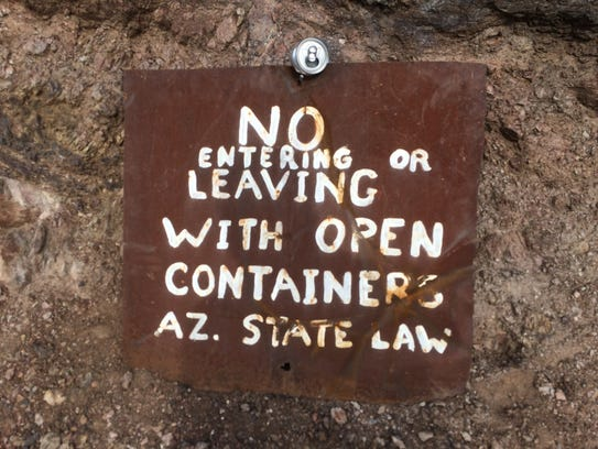 Several signs around the Desert Bar warn patrons that