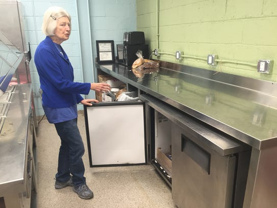 Janice Welchance shows off some of the new stainless-steel