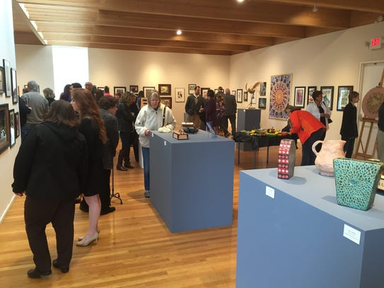 The opening reception Sunday filled the Mansfield Art