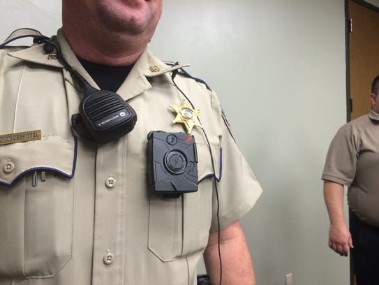 Patrol Deputy Shannon Deshotel shows off the Taser