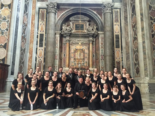 The group of Brighton High School choir students pose