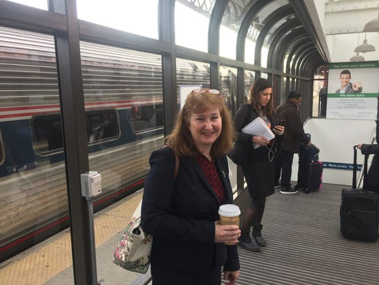 Karen Jacobs waits on the platform at the train station