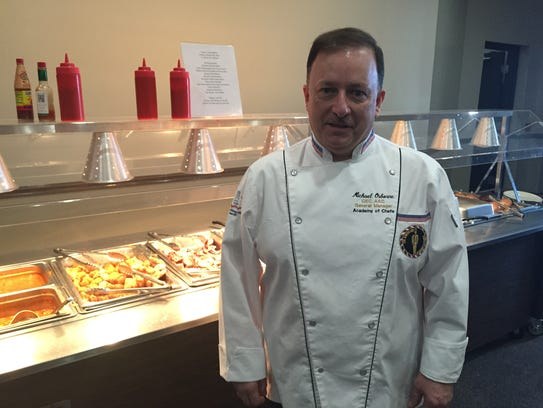 Chef Michael Osborne stands in front of the Smyrna