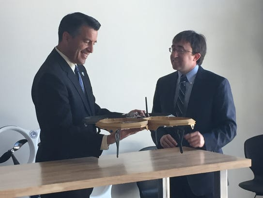 Gov. Brian Sandoval checks out one of the drones at