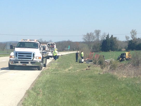 Crews clean up debris from a vehicle crash that happened