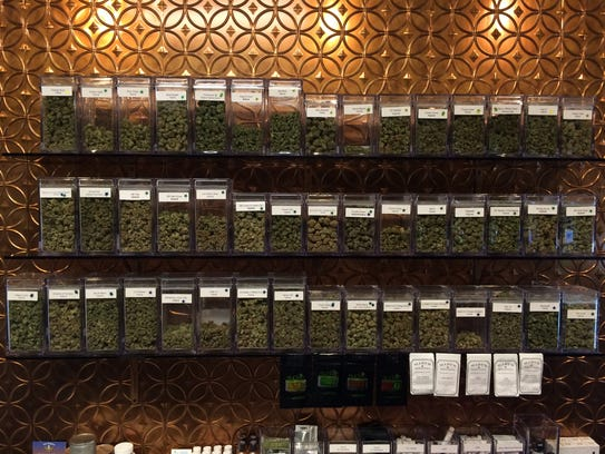 Glass jars of high-grade Colorado-grown marijuana sit