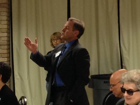 Jerome Puyau speaks in 2015 at a legislative breakfast