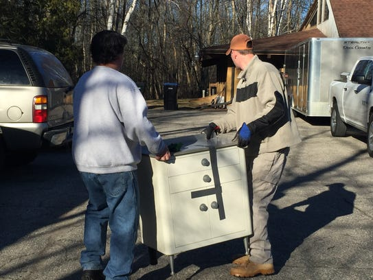 Volunteers move furniture out of the Community Clinic