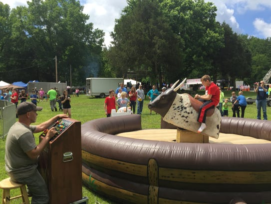 A mechanical bull was a new activity for Eagle Fest