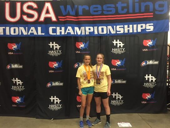 Carly Gross and Tiffani McNelis pose with their medals