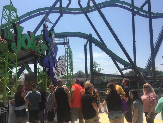 Guests wait on line for The Joker at Six Flags Great