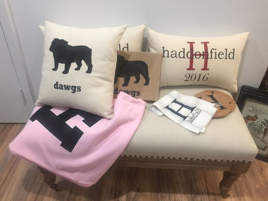 Cathy Kaplan designs and sews many of the pillows offered