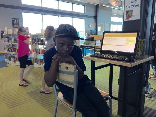 Eight-year-old Trenton Brittingham, a second grade