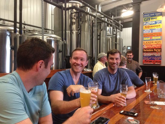 Customers drink beer and share laughs at Queen City