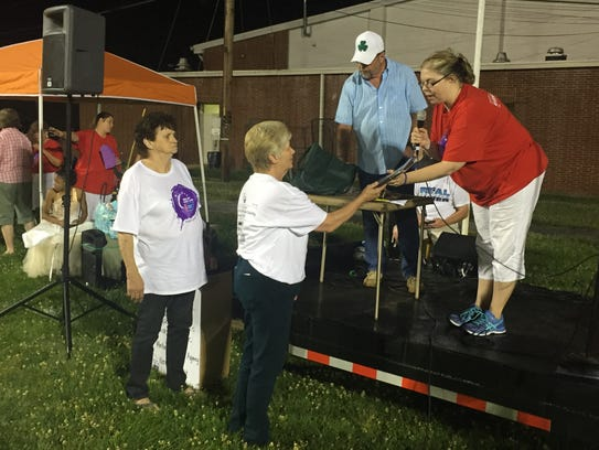 Cedar Valley Church members receive a plaque from Relay