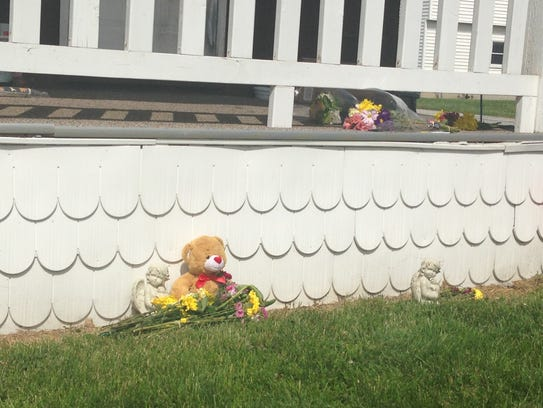 Flowers and teddy bear left outside where two died