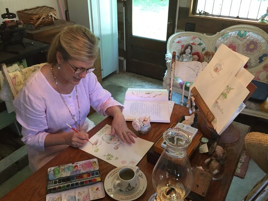 In her studio, Christie Jones Ray works on her book