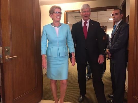 Ontario Premier Kathleen Wynne and Gov. Rick Snyder