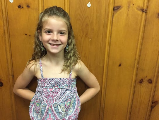Alanah Snavely, 7, was bitten by a rabid cat in North