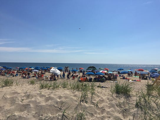 Crowds gather on the beach just off the Bethany Beach