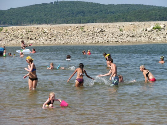 Moonshine Beach visitors enjoy the water at Table Rock