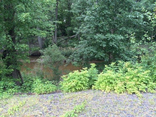 Mill Creek runs next to the Ohio Lumber plant in Sherry,