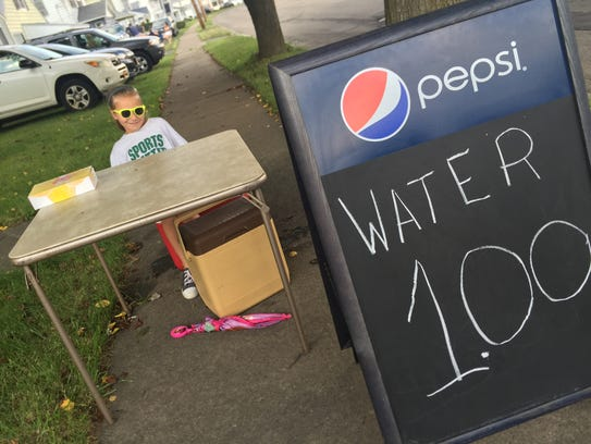 Malaina Boreffi, 7, of Endicott, sells water on Friday
