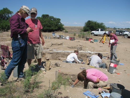 A team works at an archaeological site called  Bloom