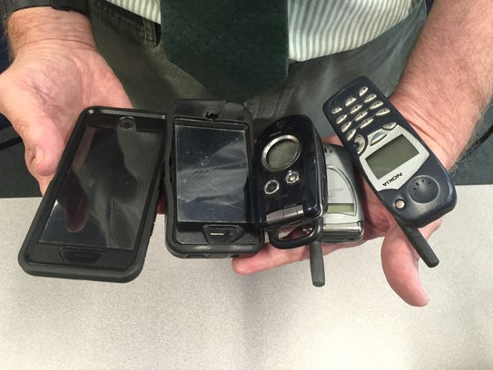 Chief Doug Brent shows the number of mobile phones