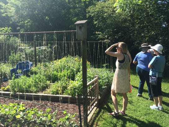 Visitors view one of the sites on the Fairview Garden