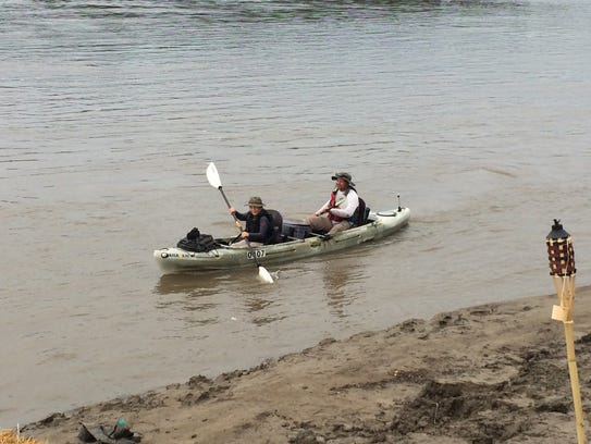 Konner Norman, 11, in front, and dad Matt Norman paddle