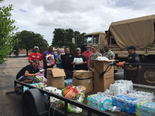 Volunteers from Crossroads Church help load supplies