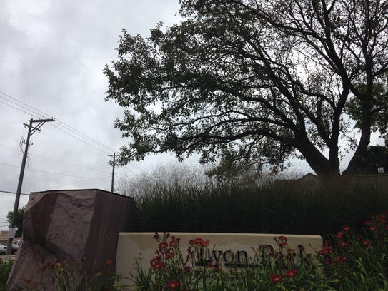 "Lyon Park's sign no longer has the sculpture, ""Effortlessly"