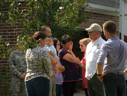 Gov. John Bell Edwards speaks with a Youngsville family